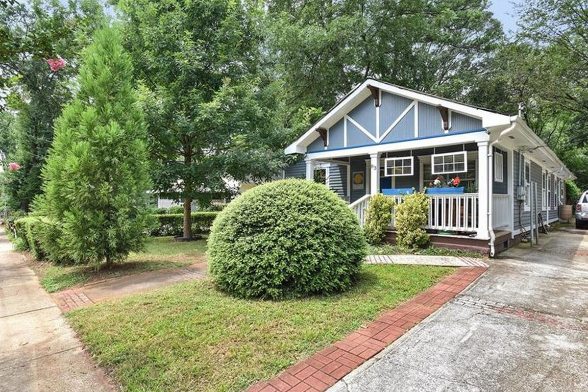 A blue cottage for sale in the Edgewood neighborhood of Atlanta.