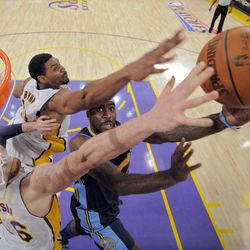 Denver Nuggets point guard Ty Lawson, right, puts up a shot as Los Angeles Lakers center Andrew Bynum, upper left, and power forward Pau Gasol of Spain defend during the first half of an NBA first-round playoff basketball game, Sunday, April 29, 2012, in Los Angeles.