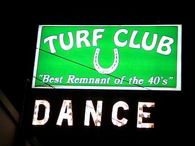 The green sign of The Turf Club on University Avenue