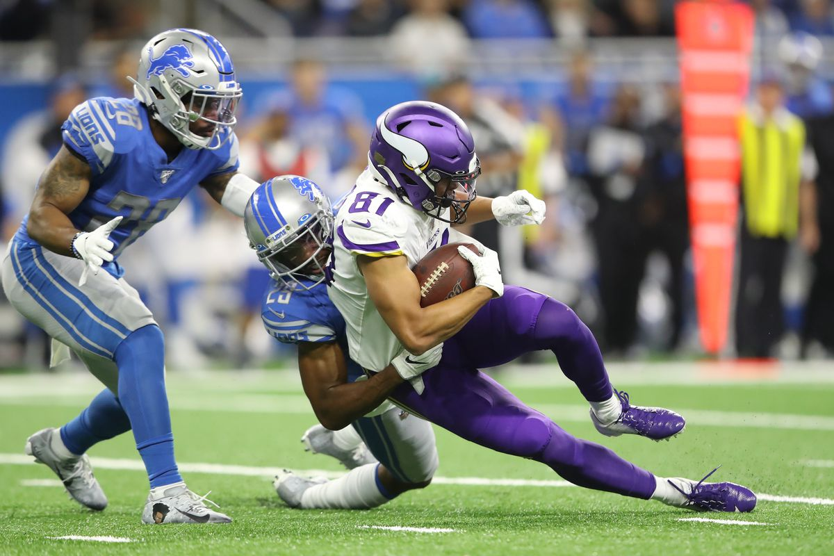 Bisi Johnson of the Minnesota Vikings makes a catch in the third quarter of the game against the taken down by Darius Slay of the Detroit Lions at Ford Field on October 20, 2019 in Detroit, Michigan.