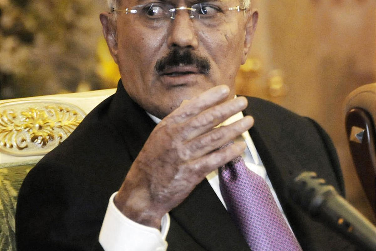 FILE - In this Saturday, Dec. 24, 2011 file photo, Yemen's President Ali Abdullah Saleh speaks to reporters during a press conference at the Presidential Palace in Sanaa, Yemen. Gunmen loyal to Yemen's ousted president blasted buildings at the country's m