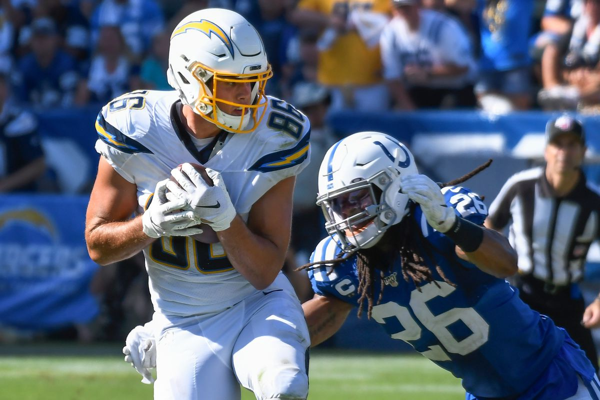 Los Angeles Chargers tight end Hunter Henry makes a catch in front of Indianapolis Colts strong safety Clayton Geathers during overtime at Dignity Health Sports Park.