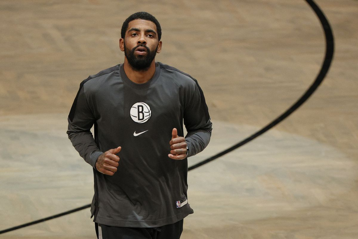 Kyrie Irving of the Brooklyn Nets looks on during warmups before the game against the Washington Wizards at Barclays Center on January 03, 2021 in the Brooklyn borough of New York City.