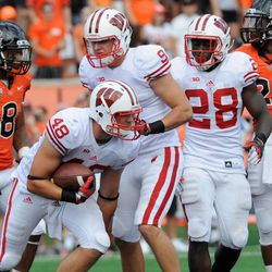 Wisconsin's Jacob Pederson (48) celebrates his touchdown reception against Oregon State during the second half of their NCAA college football game in Corvallis, Ore., Saturday Sept. 8, 2012.