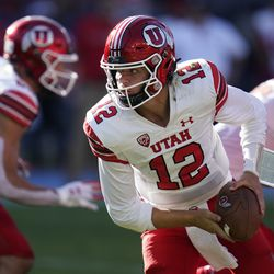 Utah quarterback Charlie Brewer (12) looks to hand off the ball during the first half of an NCAA college football game against San Diego State Saturday, Sept. 18, 2021, in Carson, Calif.