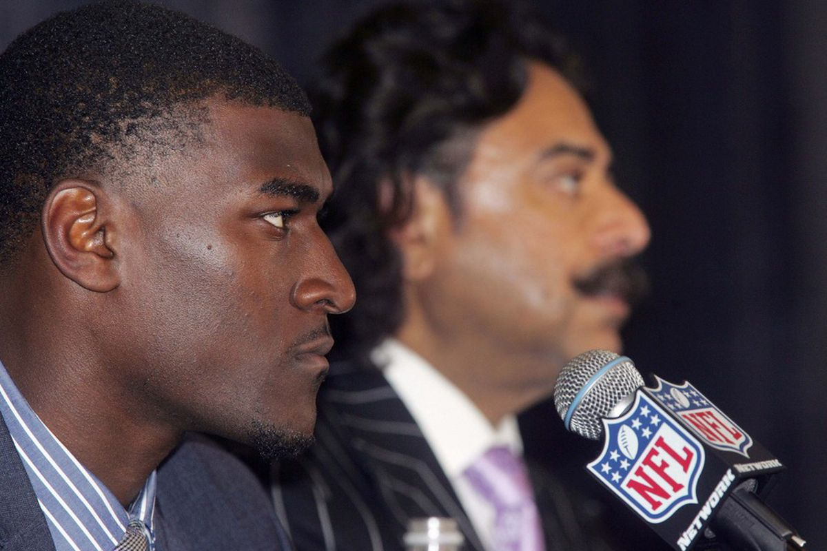 April 27, 2012; Jacksonville FL, USA;  Jacksonville Jaguars first round draft pick Justin Blackmon and owner Shad Khan listen during a press conference at EverBank Field. Mandatory Credit: Phil Sears-US PRESSWIRE