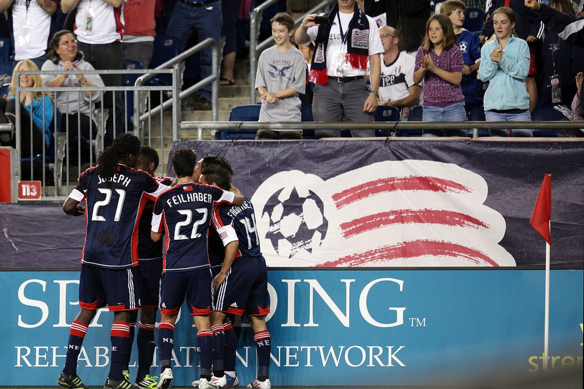 FOXBORO, MA - MAY 12: New England Revolution teammates crowd Lee Nguyen after he scored his second unassisted goal against the Vancouver Whitecaps at Gillette Stadium May 12, 2012 in Foxboro, Massachusetts. (Photo by Gail Oskin/Getty Images)