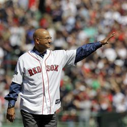 Former Boston Red Sox manager Terry Francona waves to cheering fans at Fenway Park in Boston, Friday, April 20, 2012 during a celebration of the 100th anniversary of the first regular-season game at Fenway Park,  prior to a baseball game against the New York Yankees.