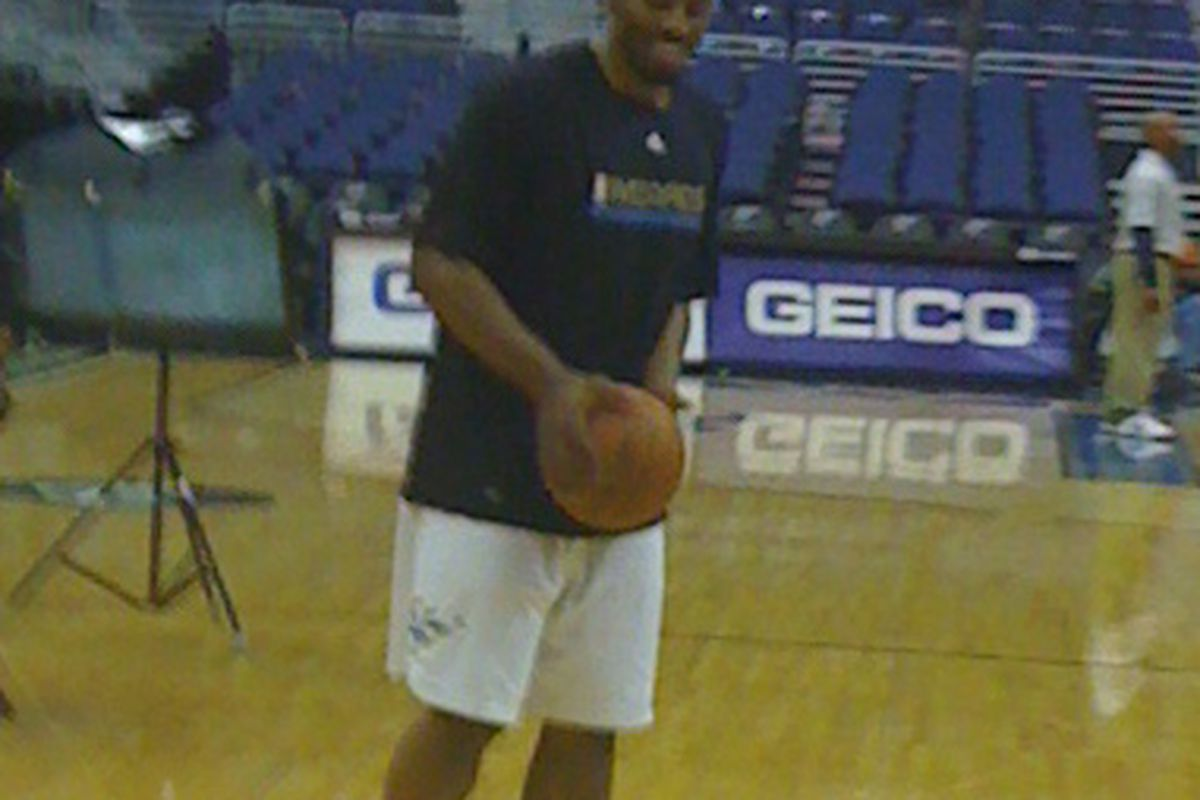 Mike Harris smiles as he warms up for his first game with the Wizards.  Via my Iphone.
