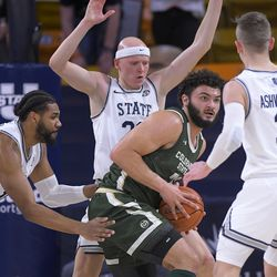 Colorado State guard David Roddy (21) looks to pass the ball as Utah State forward Alphonso Anderson, left, guard Brock Miller and guard Steven Ashworth defend during the second half of an NCAA college basketball game Thursday, Jan. 21, 2021, in Logan, Utah.