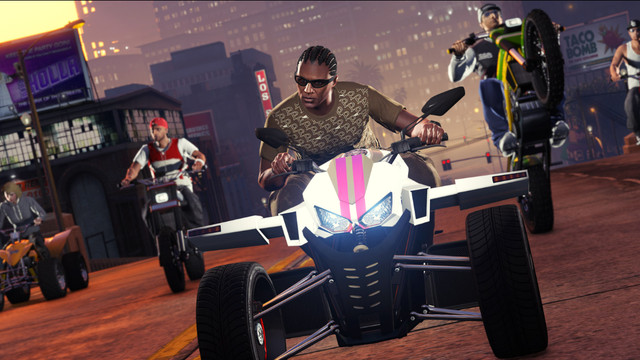 Grand Theft Auto Online - a selection of players pose on luxury vehicles