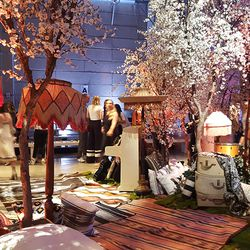 Gypset-inspired decor touches included musical instruments, faux cherry blossom trees, and printastic rugs.