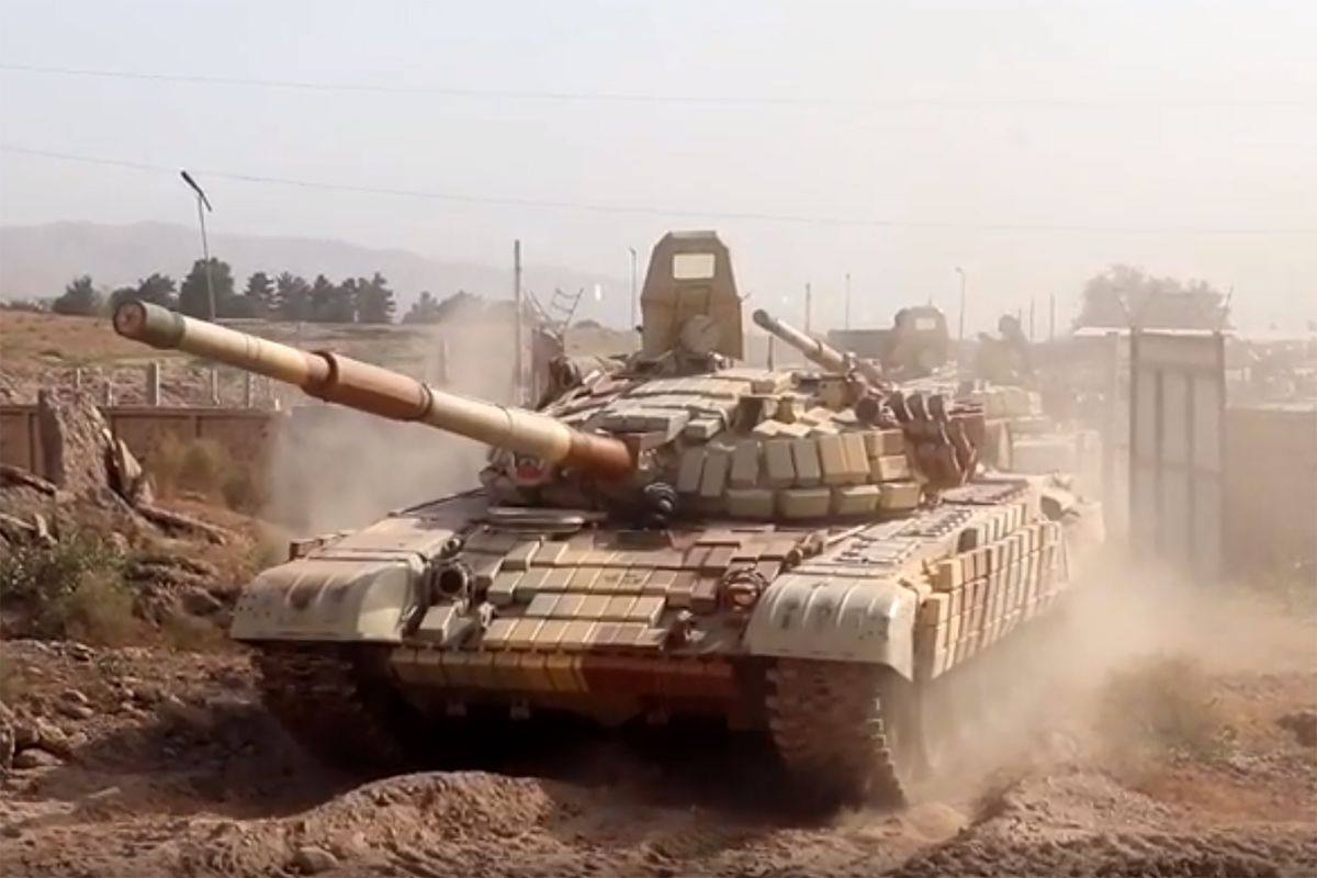 Tank units redeployed from Russian military base in Tajikistan to training ground near Afghan border