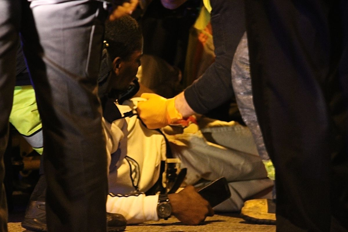 A 24-year-old man who was shot early Thursday in the South Loop is given medical attention by paramedics. | Daniel Brown/Sun-Times