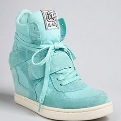 """<strong>Ash</strong> Lace Up Wedge, <a href=""""http://www1.bloomingdales.com/shop/product/ash-lace-up-wedge-sneakers-cool?ID=678793&CategoryID=17400#fn=spp%3D3%26ppp%3D96%26sp%3D1%26rid%3D5%26spc%3D160"""">$195</a>"""