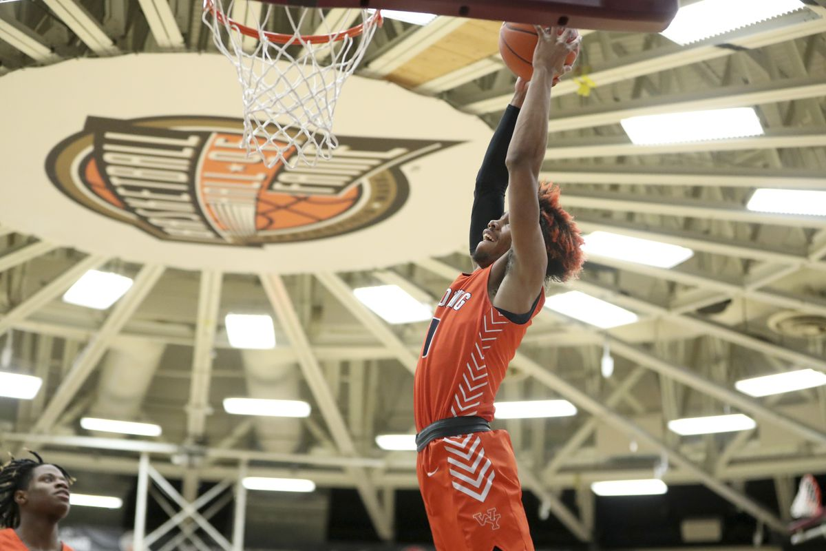 Young's Tyler Beard #0 dunks against Mount Vernon, NY at the Hoophall Classic.