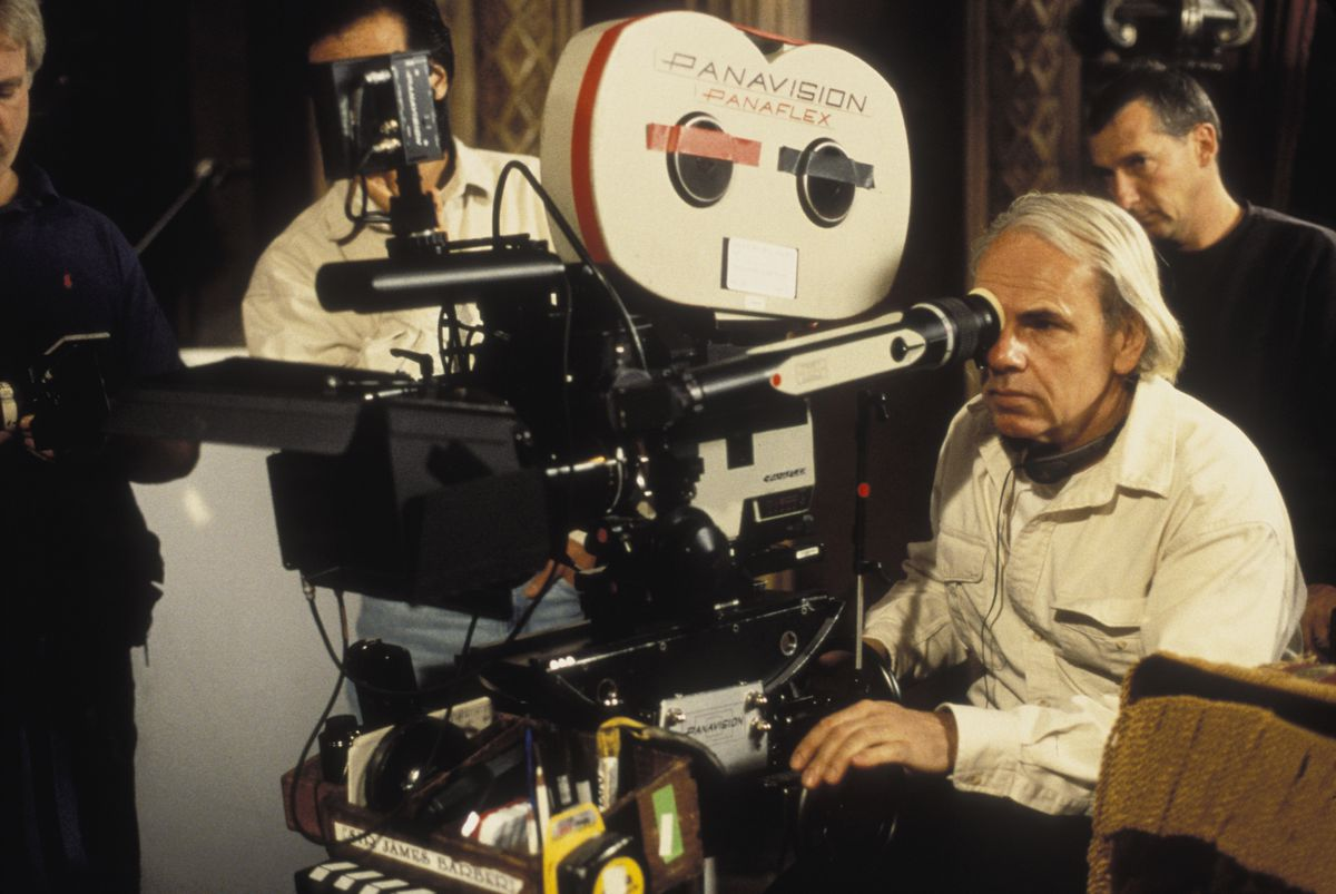 Director Jan de Bont looks through a camera eyepiece on the set of The Haunting
