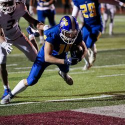 Orem's Kolton Brown scores a touchdown in the 5A football state championship game against Timpview at Cedar Valley High in Eagle Mountain on Friday, Nov. 20, 2020.