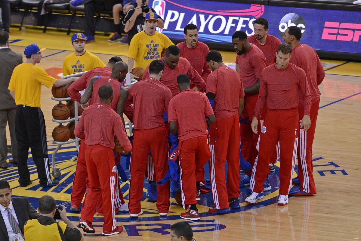 Los Angeles Clippers remove their warm up jackets in sign of protest over the alleged racist remarks made by their owner Donald Sterling before playing the Golden State Warriors in Game 4 of their Western Conference NBA playoff at Oracle Arena in Oakland,