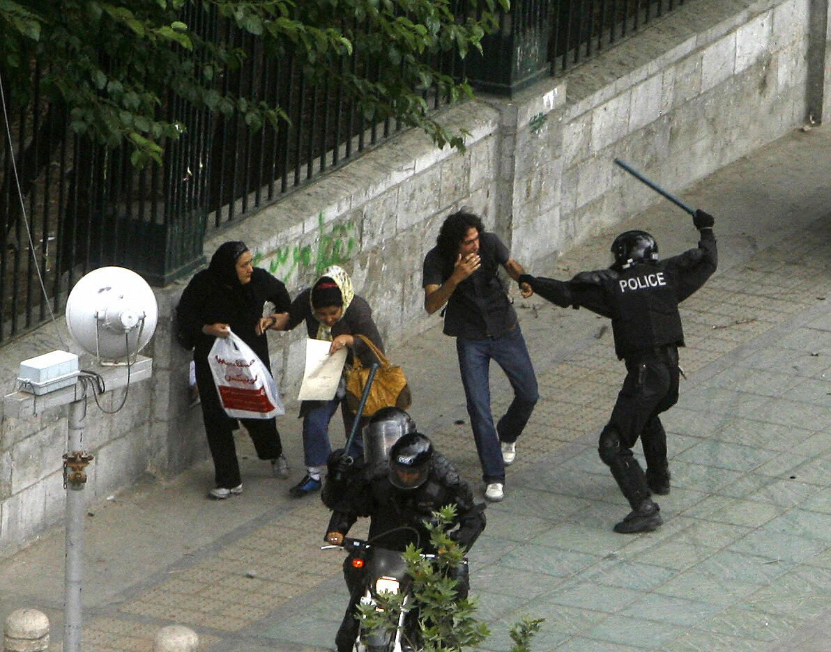 An Iranian riot policeman beats a protestor during 2009 demonstrations. STR/AFP/Getty Images
