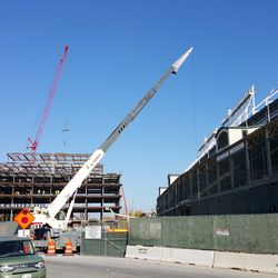 10:53 a.m. View of plaza building, west side of ballpark, and cranes -