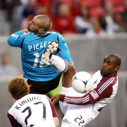 Goalkeeper Matt Pickens, Kosuke Kimura and Marvell Wynne of the Colorado Rapids attempt to clear the ball from the goal against Real Salt Lake during their MLS match up at Rio Tinto Stadium in Sandy Saturday, April 7, 2012.