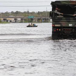 Louisiana nation Guard patrols Highway 51 in LaPlace, La., that is still flooded by Hurricane Isaac Friday Aug. 31, 2012.