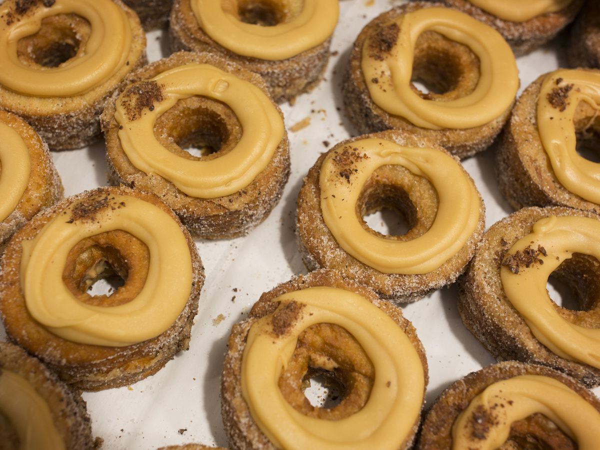 Circular fried doughnuts with frosting on top