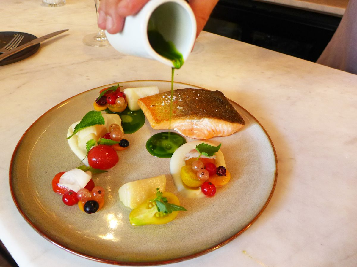 The artic char entree featured a profusion of small fresh berries and a bit of tableside preparation.