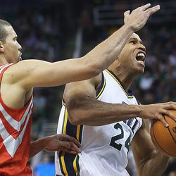 Utah Jazz's small forward Richard Jefferson (24) drives past Houston's Francisco Garcia as the Jazz and the Rockets play Saturday, Nov. 2, 2013 in EnergySolutions arena. Jazz lost 104-93.