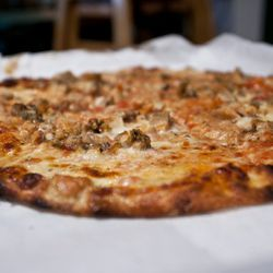 """Clam pie from Frank Pepe's by <a href=""""http://www.flickr.com/photos/nicknamemiket/5932227477/in/pool-29939462@N00/"""">nicknamemiket</a>."""
