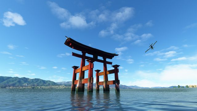 Itsukushima Shrine, an orange torii gate standing in water, in Microsoft Flight Simulator