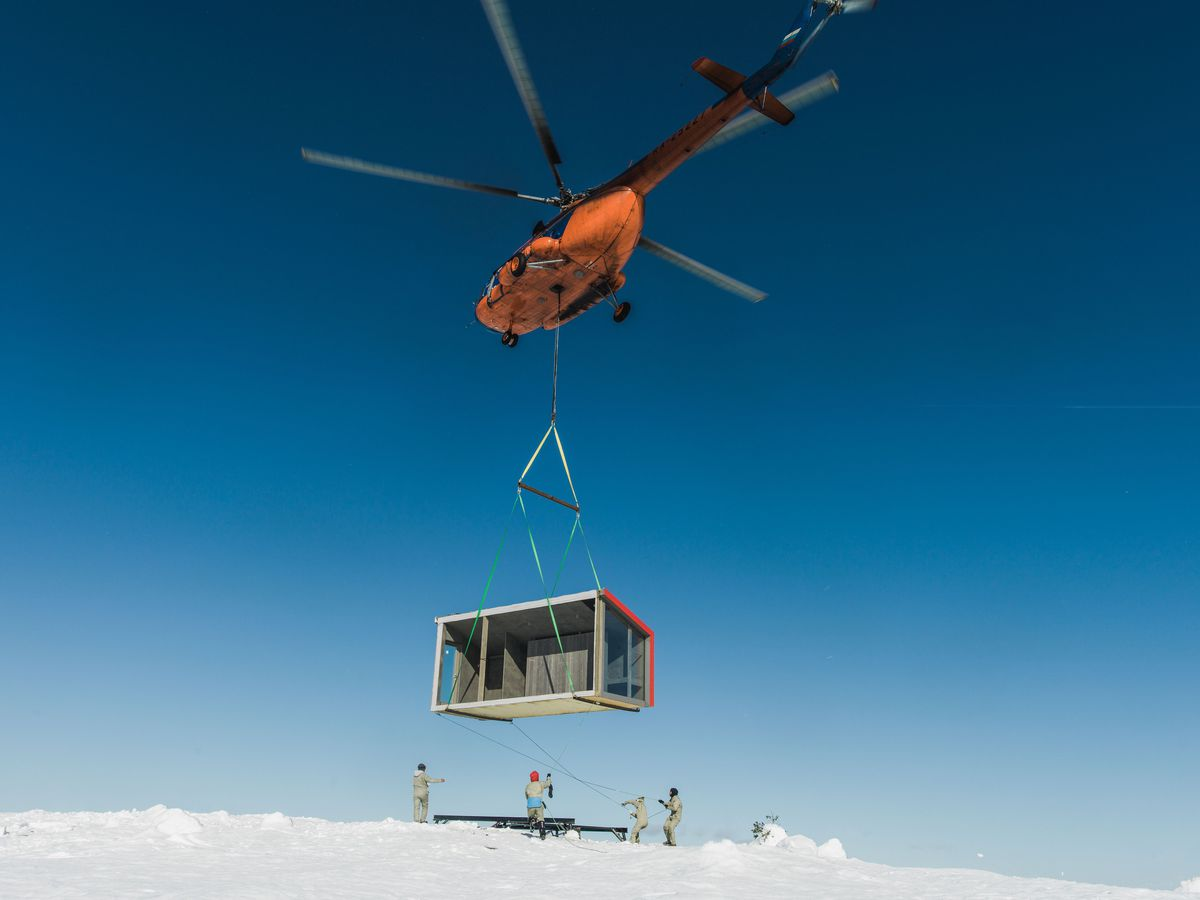 Helicopter dropping prefab home into place
