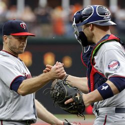 Minnesota Twins relief pitcher Brandon Kintzler, left, and catcher Chris Gimenez embrace after closing out a baseball game against the Baltimore Orioles in Baltimore, Wednesday, May 24, 2017. Minnesota won 4-3. (AP Photo/Patrick Semansky)
