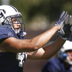 BYU running back Harvey Unga, a junior, has his eyes set on becoming the Cougars' all-time leading rusher — if he can keep from getting injured.