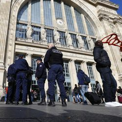 French police officers patrol outside the Gare du Nord train station, where high speed trains depart to Brussels, in Paris, Tuesday, March 22, 2016. Authorities in Europe and across the world tightened security at airports, railway stations, government buildings and other key points after deadly attacks Tuesday on the Brussels airport and its subway system.