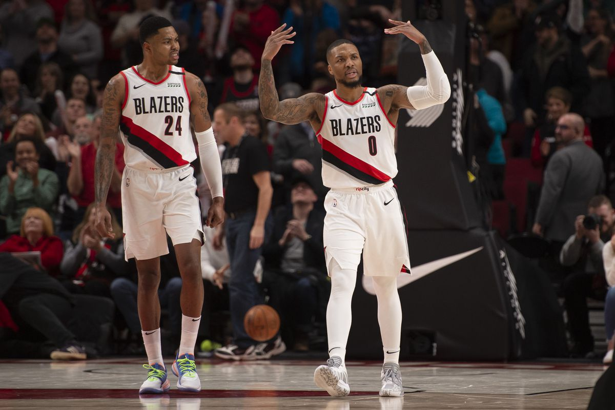 Portland Trail Blazers guard Damian Lillard encourages fans to cheer after making a shot during the second half against the Charlotte Hornets at Moda Center.