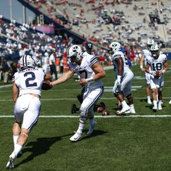 Brigham Young Cougars quarterback Beau Hoge (7) hands the ball to running back Austin Kafentzis (2) during warm ups for the game against the Wisconsin Badgers at LaVell Edwards Stadium in Provo on Saturday, Sept. 16, 2017.