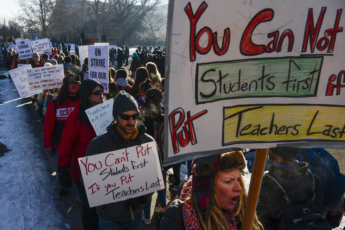 Denver teachers, students and community members picket outside South High School on February 11, 2019 in Denver, Colorado. Denver teachers are striking for the first time in 25 years after the school district and the union representing the educators faile