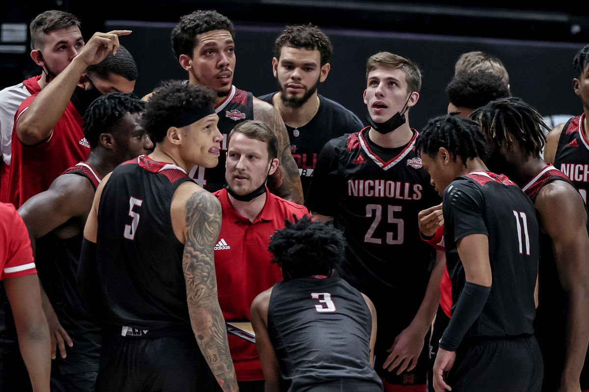 Nicholls State Colonels head coach Austin Claunch in a time out huddle with the players against LSU Tigers in the second half at the Pete Maravich Assembly Center.