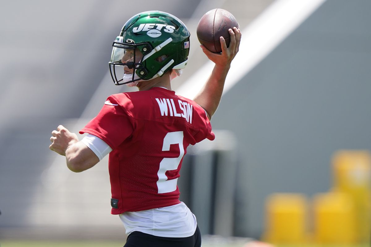 New York Jets quarterback Zach Wilson prepares to pass during an NFL football practice.