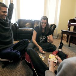 Jeff Griffin celebrates beating his wife Emily and son Bradley at UNO in their home in West Jordan on Thursday, Feb. 27, 2014.