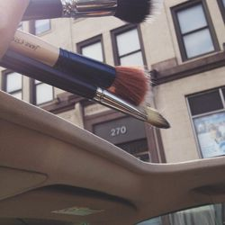 In my line of work, sometimes in between jobs, you have to hold your recently cleaned makeup brushes out the sunroof to dry.