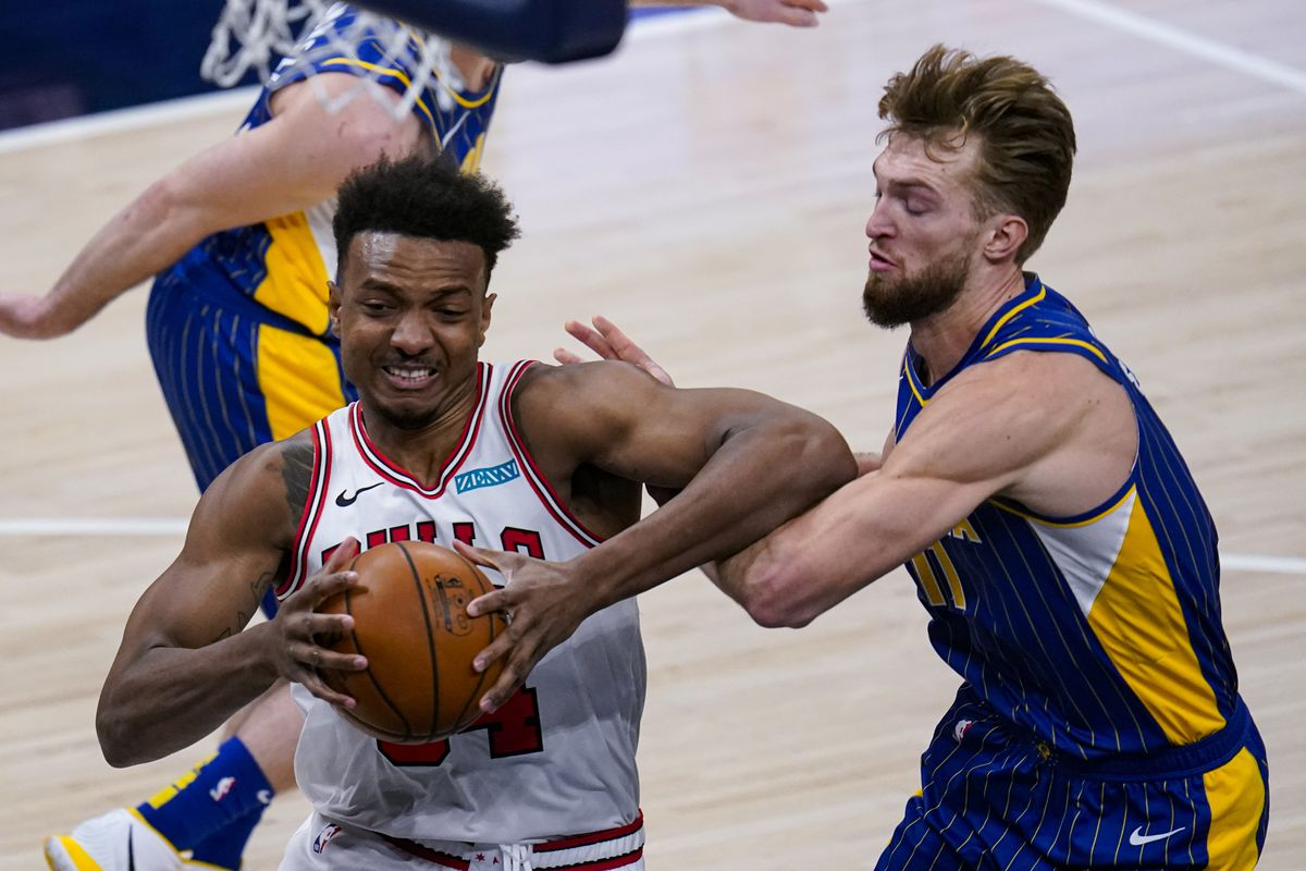 Bulls center Wendell Carter Jr. drives on Pacers forward Domantas Sabonis on Monday night in Indianapolis.