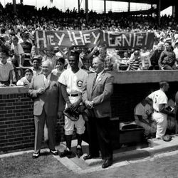 Ernie in front of fans and the dugout at Wrigley on Ernie Banks Day, August 15, 1964