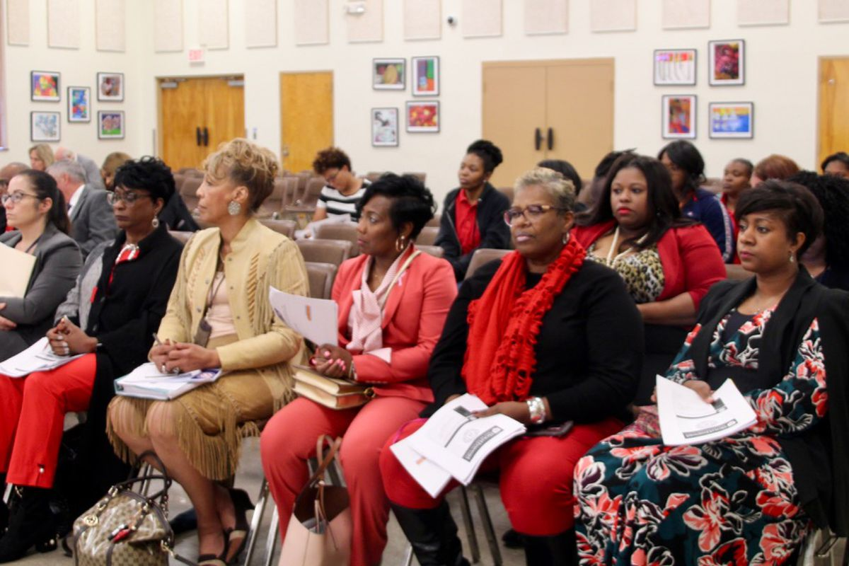 Members of the public listen during a hearing for Southwest Early College High School.