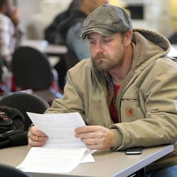 Jeremiah Hinesley fills out an application for the Supplemental Nutrition Assistance Program at the Utah State Metro Employment Center in Salt Lake City on Friday, Dec. 11, 2015.
