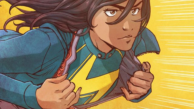 Ms. Marvel, aka Kamala Khan, a Pakistani-American Muslim superhero from Jersey City, springs into action, pulling her every day clothing open to reveal the yellow lightning bold insignia of her costume, in Ms. Marvel #13, Marvel Comics (2015).