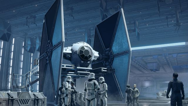 Imperials stand around a hangar with TIE fighters