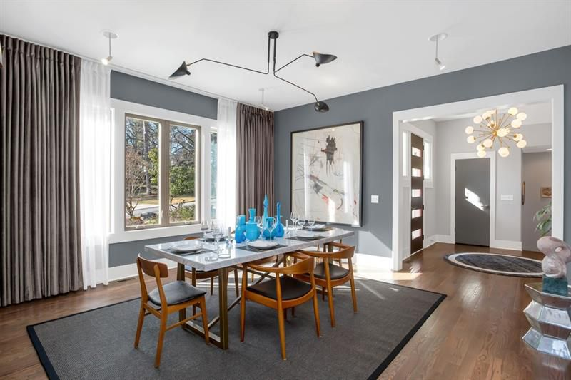 A dining room with blue walls.